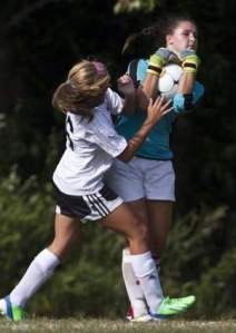 Old Bridge's Melanie Santurro collides with Bishop Ahr goalkeeper Brianna Foster in the first half of their matchup on Sept. 10.  Photo by: Doug Hood