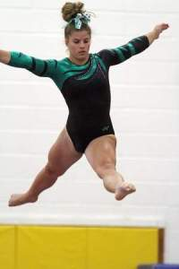South Plainfield's Nicole Sottiriou competes on the balance beam in Saturday's Raider Invitational. Photo by: Kathy Johnson.