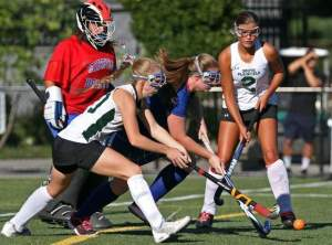 Sayreville and South Plainfield battle for the ball in their game Tuesday. Photo by: Kathy Johnson