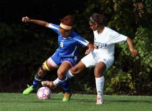 Carteret's Ciara Alston (left) battles for the ball with Metuchen's Tracy Michalski during the first half of Wednesday's game. Photo by: Mark R. Sullivan