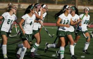 East Brunswick high school field hockey players celebrate their first goal against South Brunswick Tuesday. Photo by: Ed Pagliarini