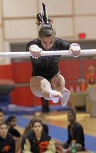 Bridgewater-Raritan's Emily Shugan competes on the uneven bars in Saturday's NJSIAA Central sectionals. Photo by: Kathy Johnson