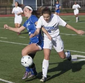 Metuchen's Melissa Chura battles for the ball against Shore Thursday. Photo by: Bob Bielk