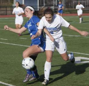 Metuchen's Melissa Chura battles for the ball against Shore Thursday. Photo by: Bob Bielk