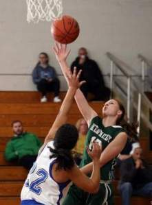 Taylor Freeman, of J.F. Kennedy attempts a layup over Carteret defender Courtney Hansen in an opening-round game of the Gene Haley Girls Basketball Holiday Tournament Friday. Photo by: Jody Somers