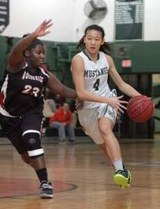 John F Kennedy's Jolie Tang (4) drives around Woodbridge's Brielle Bannister on Monday in Woodbridge. Photo by: Ed Pagliarini