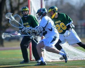 North Hunterdon goalie Liam Pearson stands ready as Ridge's J.T. Pelledino comes around to shoot, trailed by North Hunterdon's Pat Smith in Wednesday's season opener. Photo by: Karen Mancinelli