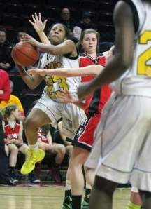 Piscataway's Taylor Nelson (23) fights her way toward the basket during the second half of the Greater Middlesex Conference Tournament final on Thursday in Piscataway. Photo by: Mark R. Sullivan