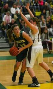North Hunterdon's Allison Lane looks to pass the ball despite coverage by Phillipsburg's Ally Raulf in the Hunterdon/Warren/Sussex Tournament final on Friday. Photo by: Keith A. Muccilli