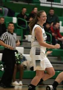 South Plainfield's Kate McLaughlin is all smiles after scoring her 1,000th point during Tuesday's game against Governor Livingston. Photo by: Ed Pagliarini