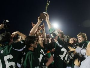 Ridge players celebrate winning the Somerset County Tournament title Thursday night. Photo by: Jason Towlen